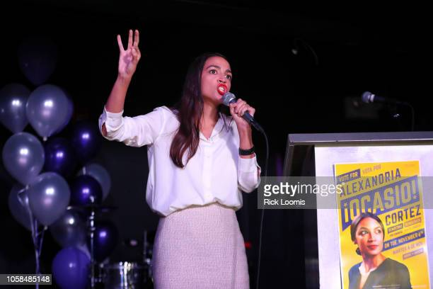 Alexandria OcasioCortez addresses the crowd gathered at La Boom night club in Queens on November 6 2018 in New York City With her win against...