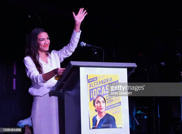 TOPSHOT Alexandria OcasioCortez arrives on stage to speak to her supporters during her election night party in the Queens Borough of New York on...