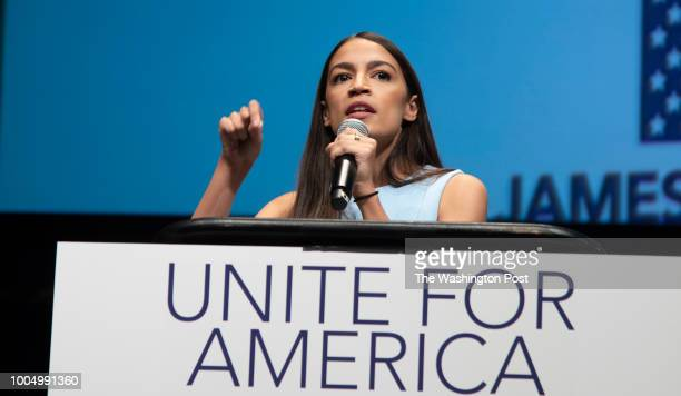 Alexandria OcasioCortez delivers her message at a campaign rally in Wichita Kansas on July 20 2018 Bernie Sanders held a rally with rising stars in...