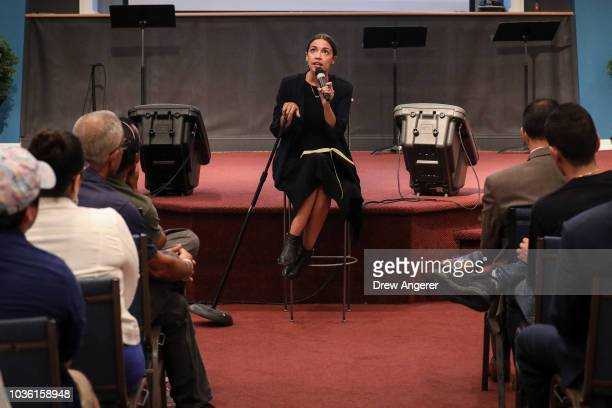 Alexandria OcasioCortez Democratic candidate running for New York's 14th Congressional district answers questions at a town hall event September 19...