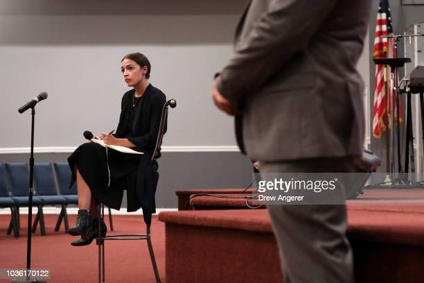 Alexandria OcasioCortez Democratic candidate running for New York's 14th Congressional district takes questions at a town hall event September 19...