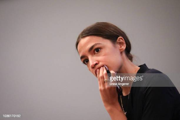 Alexandria OcasioCortez Democratic candidate running for New York's 14th Congressional district listens to questions at a town hall event September...