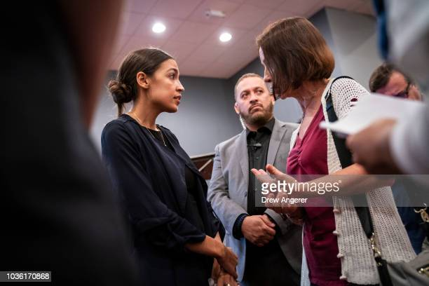 Alexandria OcasioCortez Democratic candidate running for New York's 14th Congressional district talks with a voter at the conclusion of a town hall...