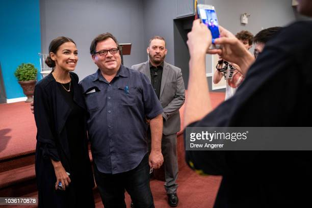 Alexandria OcasioCortez Democratic candidate running for New York's 14th Congressional district poses for photos at the conclusion of a town hall...