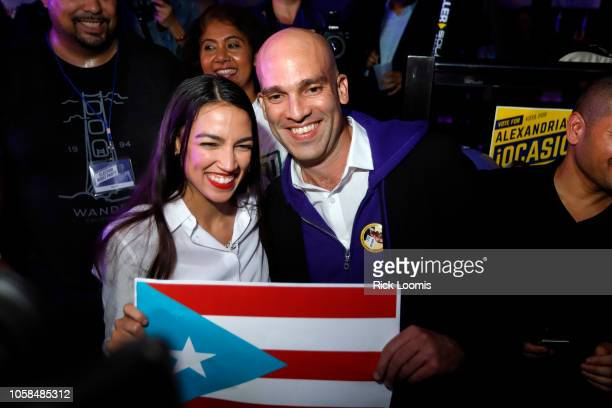 Alexandria OcasioCortez has her picture taken with Francisco Casablanca while holding the Puerto Rican flag at La Boom night club in Queens on...