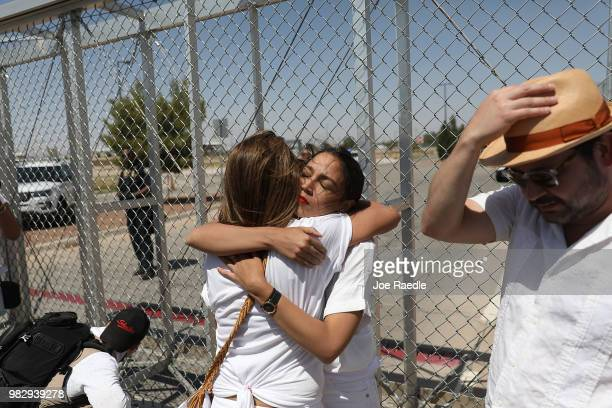 Alexandria OcasioCortez is embraced at the TornilloGuadalupe port of entry gate on June 24 2018 in Tornillo Texas She is part of a group protesting...
