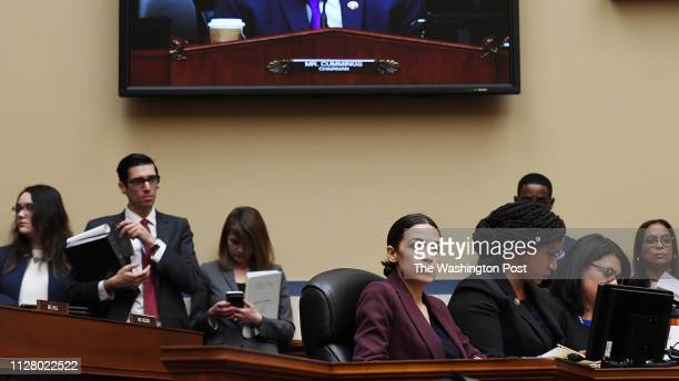 Alexandria OcasioCortez is seen as Michael Cohen former attorney to President Donald Trump testifies before the House Oversight Committee at the...