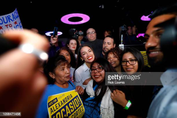 Alexandria OcasioCortez stands with supporters during her during her victory celebration at La Boom night club in Queens on November 6 2018 in New...