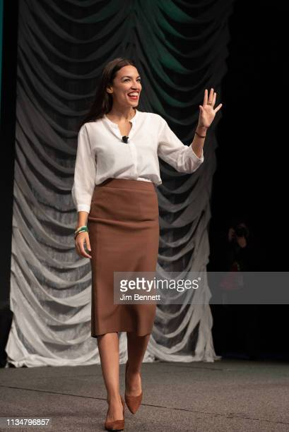 Alexandria Ocasio-Cortez walks onto the stage during the 2019 SXSW Conference and Festival at the Austin Convention Center on March 09, 2019 in...