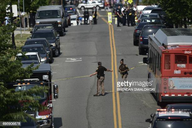 Alexandria police and emergency members gather near the crime scene of an early morning shooting in Alexandria Virginia June 14 2017 Senior...