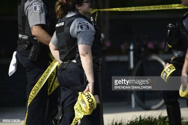 Alexandria police gather near the crime scene of an early morning shooting in Alexandria Virginia June 14 2017 Senior Republican Congressman Steve...
