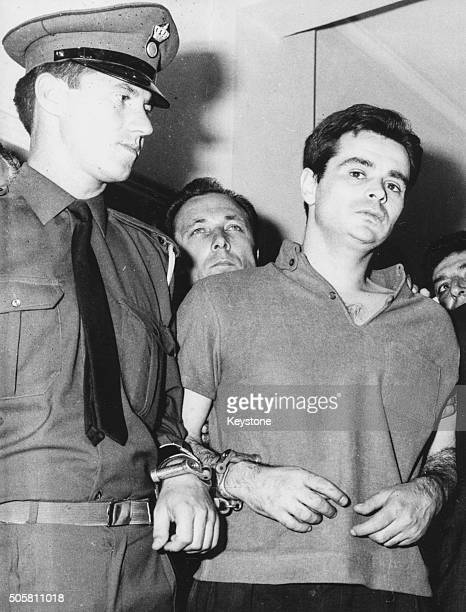 Alexandros Panagoulis being led away by an officer in military court after being sentenced to death for his assassination attempt on George...