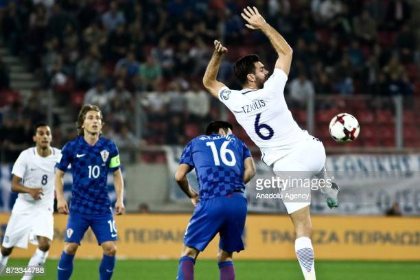 Alexandros Tziolis of Greece in action against Nikola Kalinic of Croatia during the World Cup Russia 2018 European Qualifiers match between Greece...
