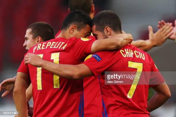 Alexandru Chipciu of Bucuresti celebrates his team's first goal with team mate Andrei Prepelita during the UEFA Europa League group E match between...