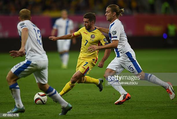 Alexandru Chipciu of Romania vies for the ball with Markus Halsti of Finland during the Euro 2016 Group F qualifying football match between Romania...