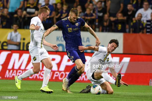 Alexandru Cretu of Maribor and Daniel Granli of AIK in action during the Second qualifying round of the UEFA Champions League between NK Maribor and...