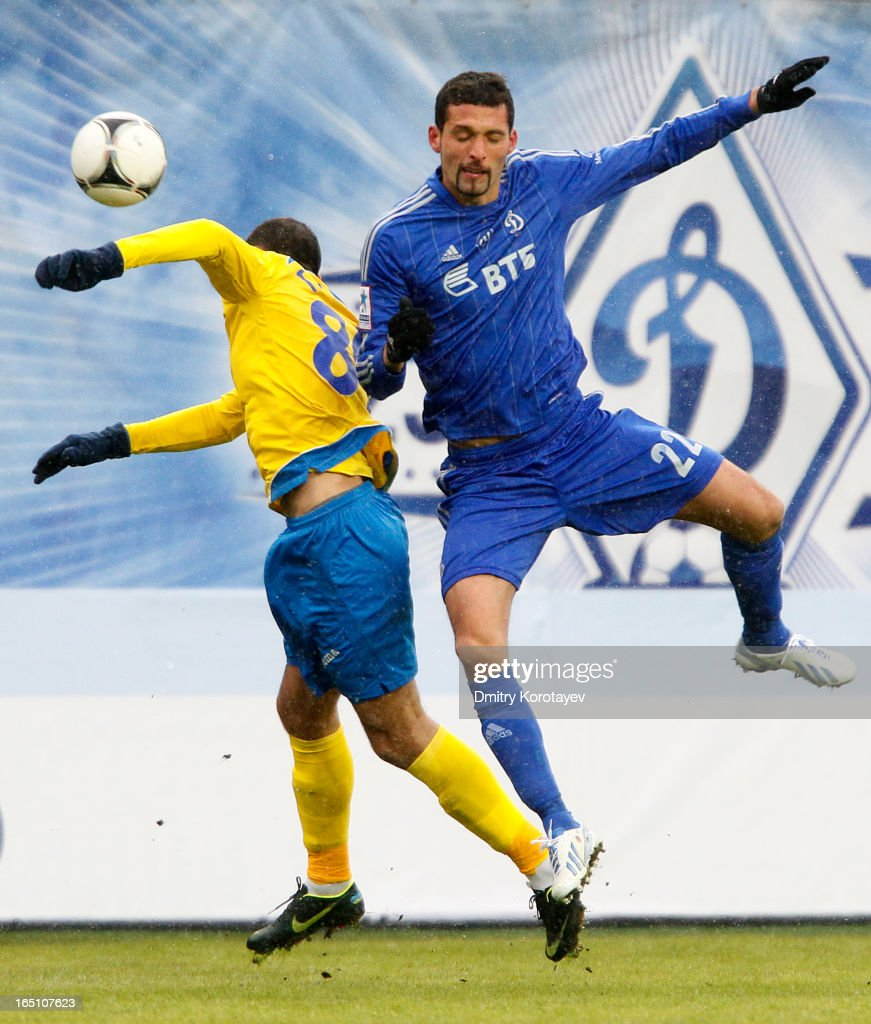 Alexandru Gatcan of FC Rostov Rostov-on-Don competes for the ball in the air with Kevin Kuranyi (R) of FC Dynamo Moscow during the Russian Premier League match between FC Dynamo Moscow and FC Rostov Rostov-on-Don at the Arena Khimki Stadium on March 30, 2013 in Khimki, Russia.