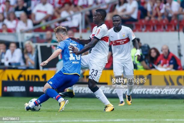 Alexandru Maxim of Mainz and Orel Mangala of Stuttgart battle for the ball during the Bundesliga match between VfB Stuttgart and 1FSV Mainz 05 at...