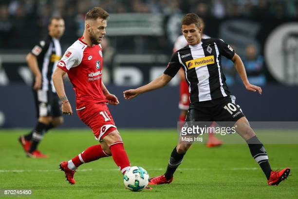 Alexandru Maxim of Mainz and Thorgan Hazard of Moenchengladbach battle for the ball during the Bundesliga match between Borussia Moenchengladbach and...