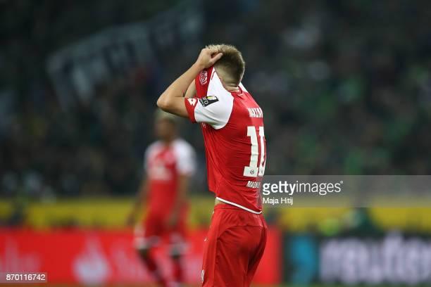 Alexandru Maxim of Mainz covers his face during the Bundesliga match between Borussia Moenchengladbach and 1 FSV Mainz 05 at BorussiaPark on November...