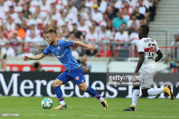 Alexandru Maxim of Mainz runs with the ball during the Bundesliga match between VfB Stuttgart and 1 FSV Mainz 05 at MercedesBenz Arena on August 26...