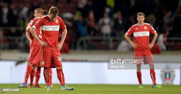 Alexandru Maxim of Stuttgart and his teammates look dejected after losing the Bundesliga match between VfB Stuttgart and VfL Wolfsburg at...