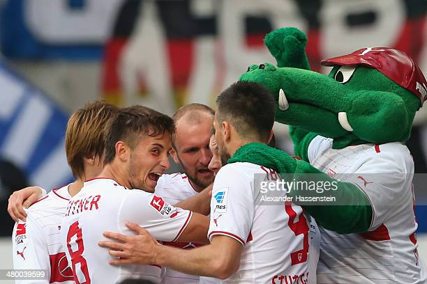 Alexandru Maxim of Stuttgart celebrates scoring the opening goal with his team mates and their mascot Fritzle the opening goal during the Bundesliga...