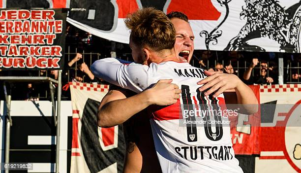 Alexandru Maxim of Stuttgart celebrates the victory with a fan during the Second Bundesliga match between Karlsruher SC and VfB Stuttgart at...