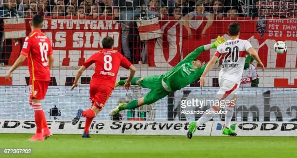 Alexandru Maxim of Stuttgart scores the first goal for his team against Daniel Mesenhoeler of Berlin during the Second Bundesliga match between VfB...