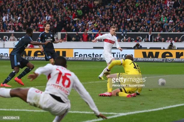 Alexandru Maxim of Stuttgart scores the opening goal against Rene Adler keeper of Hamburg during the Bundesliga match between VfB Stuttgart and...