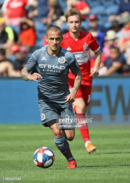 Alexandru Mitrita of New York City advances the ball in front of Djordje Mihailovic of Chicago Fire at SeatGeek Stadium on May 25 2019 in Bridgeview...