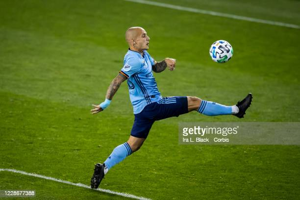 Alexandru Mitrita of New York City jumps to kick he ball in the second half of the Major League Soccer match between Toronto FC and New York City FC...