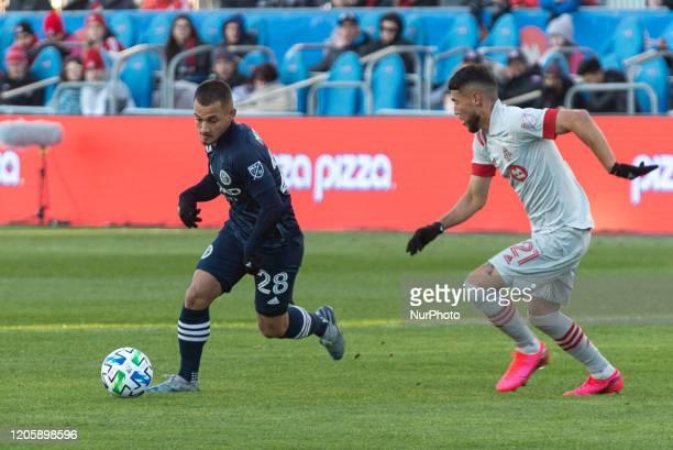 Alexandru Mitrita of New York City runs with the ball during the 2020 MLS Regular Season match between Toronto FC and New York City FC at BMO Field...