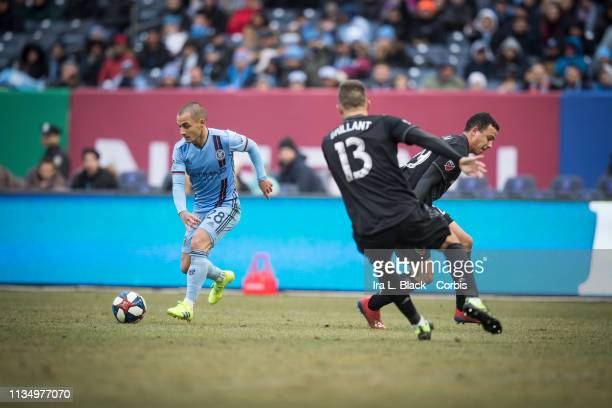 Alexandru Mitrita of New York City tries to get the shot in past Dane Kelly of DC United and Frederic Brillant of DC United during the 2019 Major...