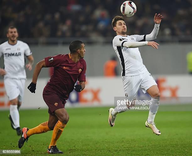 Alexandru Stan of Astra Giurgiu vies for the ball with Juan of AS Roma during the UEFA Europa League Group E football match between FC Astra Giurgiu...