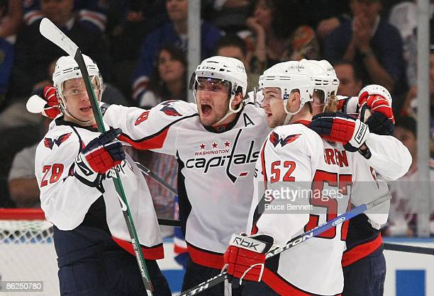 Alexaner Semin, Alex Ovechkin, Nicklas Backstrom and Mike Green of the Washington Capitals celebrate their goal at 16:44 of the second period against...