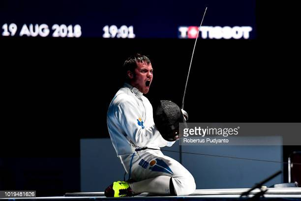 Alexanin Dmitriy of Kazakhstan celebrates victory after beating Jung Jinsun of Korea during Men's Epee Individuals Semifinal match on day one of the...