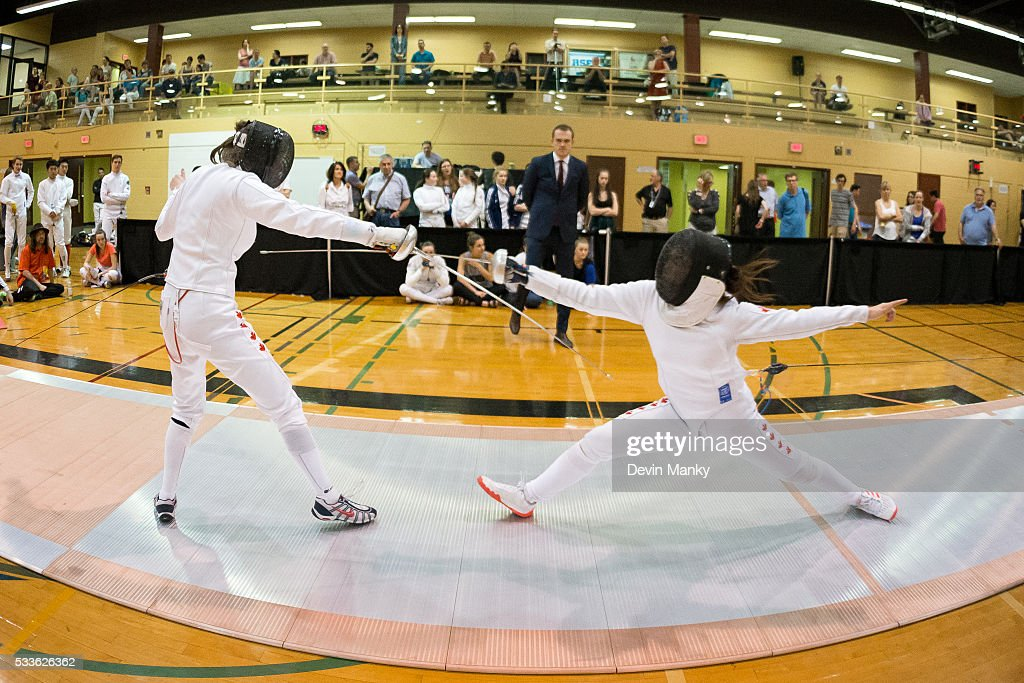 Alexanne Verret (left) fences Michelle Li in the final of the Senior Women's Epee event on May 22, 2016 at the Canadian National Fencing Championships at Centre Sportif Cegep Edouard-Montpetit in Longueuil, Quebec, Canada.