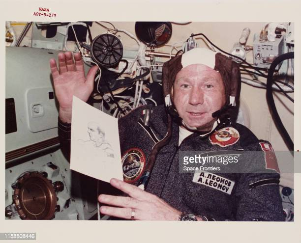 Alexei Arkhipovich Leonov the Soviet mission Commander on the joint USUSSR ApolloSoyuz Test Project holding his drawing of Apollo mission Commander...