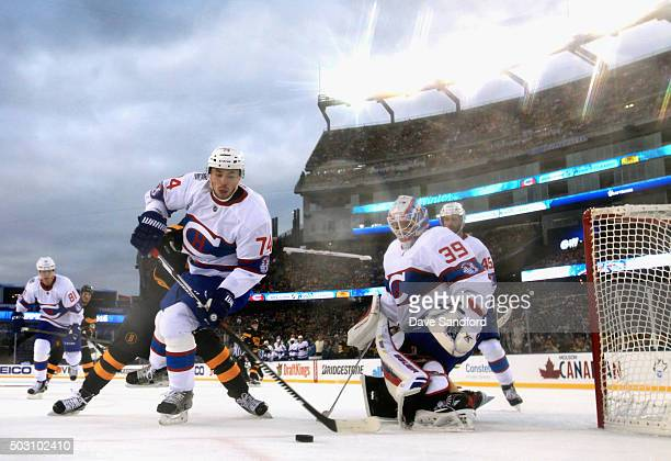 Alexei Emelin and goaltender Mike Condon of the Montreal Canadiens watch the puck during the 2016 Bridgestone NHL Classic at Gillette Stadium on...