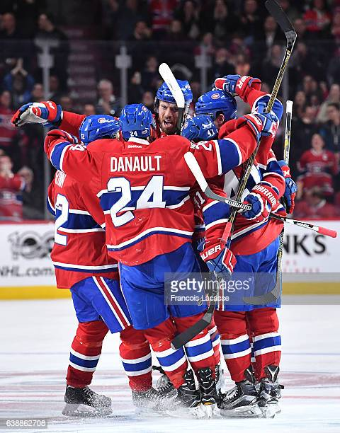 Alexei Emelin and Shea Weber of the Montreal Canadiens celebrate after scoring a goal against the New York Rangers in the NHL game at the Bell Centre...