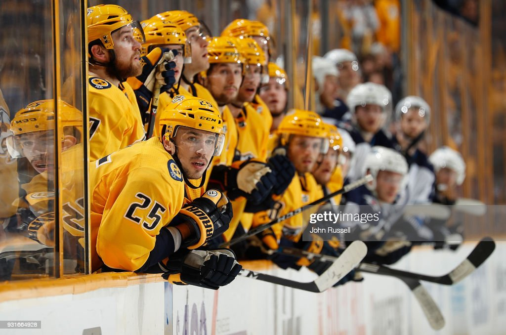 Alexei Emelin #25 and the rest of the Nashville Predators bench watch the final seconds of the third period against the Winnipeg Jets during an NHL game at Bridgestone Arena on March 13, 2018 in Nashville, Tennessee.