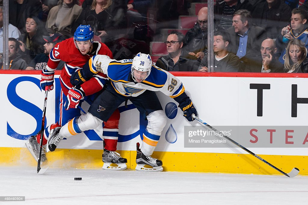 Alexei Emelin #74 of the Montreal Canadiens and Troy Brouwer #36 of the St. Louis Blues battle for the puck during the NHL game at the Bell Centre on October 20, 2015 in Montreal, Quebec, Canada. The Montreal Canadiens defeated the St. Louis Blues 3-0.