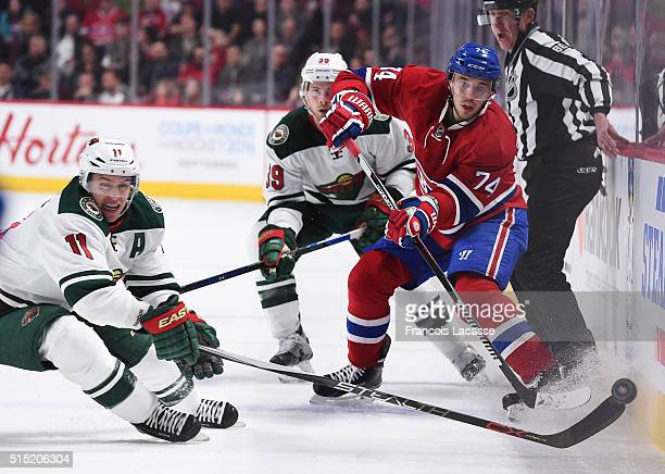 Alexei Emelin of the Montreal Canadiens clears the puck against Zach Parise of the Minnesota Wild in the NHL game at the Bell Centre on March 12 2016...