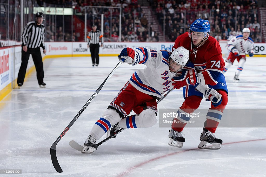 Alexei Emelin #74 of the Montreal Canadiens defends against Mats Zuccarello #36 of the New York Rangers during the NHL game at the Bell Centre on October 15, 2015 in Montreal, Quebec, Canada. The Canadiens defeated the Rangers 3-0 and for the first time in franchise history, the Canadiens have won five games in a row to start the season.