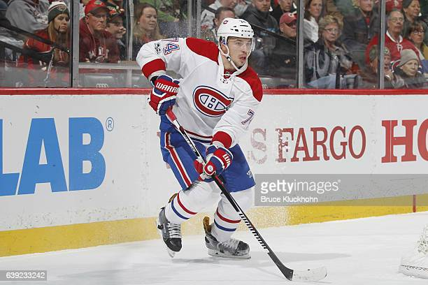 Alexei Emelin of the Montreal Canadiens handles the puck against the Minnesota Wild during the game on January 12 2017 at the Xcel Energy Center in...