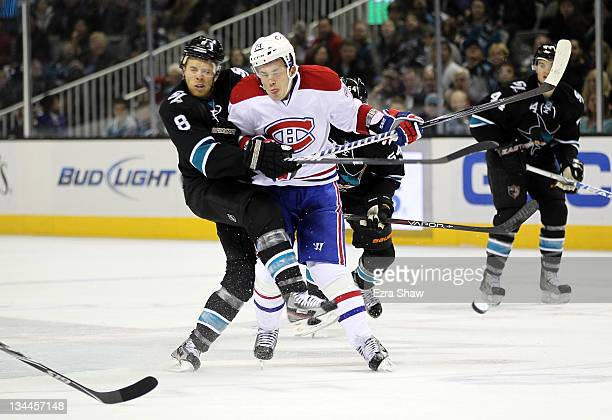 Alexei Emelin of the Montreal Canadiens hits Joe Pavelski of the San Jose Sharks at HP Pavilion at San Jose on December 1 2011 in San Jose California