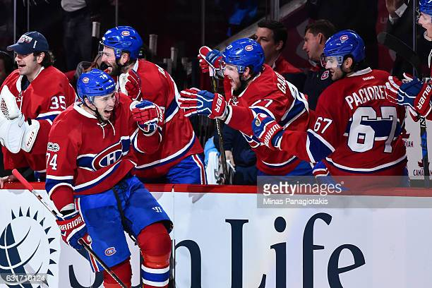 Alexei Emelin of the Montreal Canadiens reacts while celebrating his goal with teammates on the bench during the NHL game against the New York...
