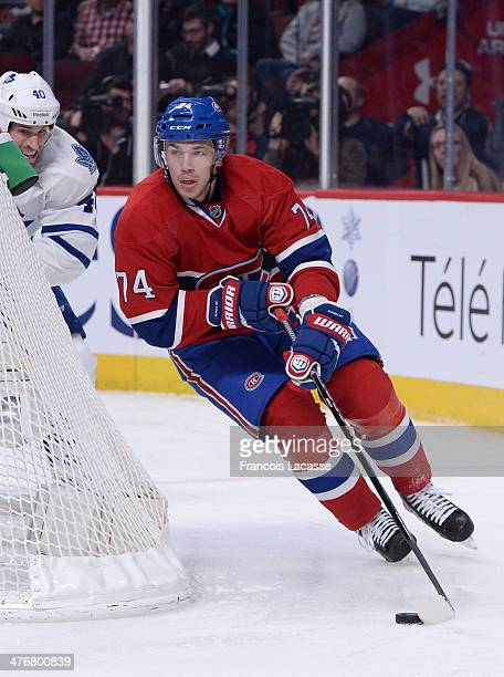 Alexei Emelin of the Montreal Canadiens skates with the puck against the Toronto Maple Leafs during the NHL game on March 1 2014 at the Bell Centre...