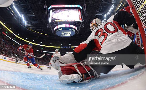 Alexei Emelin of the Montreal Canadiens takes a shot against Andrew Hammond of the Ottawa Senators in Game Two of the Eastern Conference...